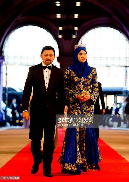 Brunei's Crown Prince AlMuhtadee Billah Bolkiah and Crown Princess Sarah pose on April 29 2013 as they arrive to attend a dinner at the National...