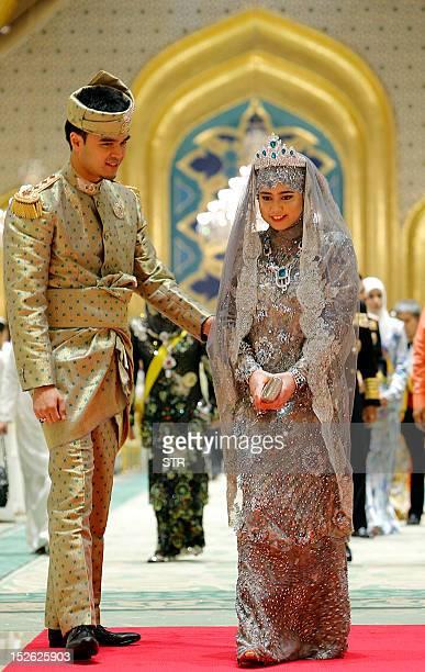 Brunei's newly wed royal couple Princess Hajah Hafizah Sururul Bolkiah and her groom Pengiran Haji Muhammad Ruzaini arrive for their wedding banquet...