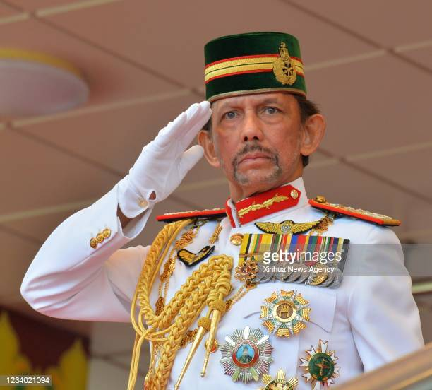 Brunei's Sultan Haji Hassanal Bolkiah salutes to the royal guard of honor during a ceremonial parade held for his 75th birthday celebration in Bandar...