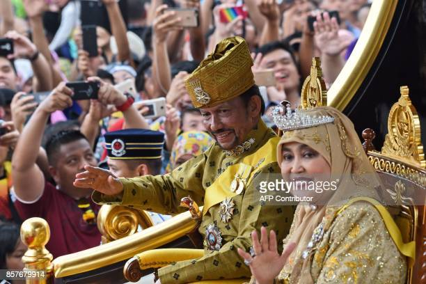TOPSHOT Brunei's Sultan Hassanal Bolkiah and Queen Saleha ride in a royal chariot during a procession to mark his golden jubilee of accession to the...