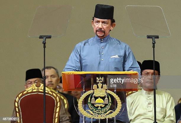 Brunei's Sultan Hassanal Bolkiah delivers a speech during the official ceremony of the implementation of Sharia Law in Bandar Seri Begawan on April...