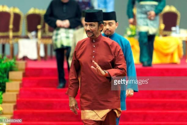 Brunei's Sultan Hassanal Bolkiah leaves after speaking at an event in Bandar Seri Begawan on April 3 2019 Brunei's sultan called for stronger Islamic...