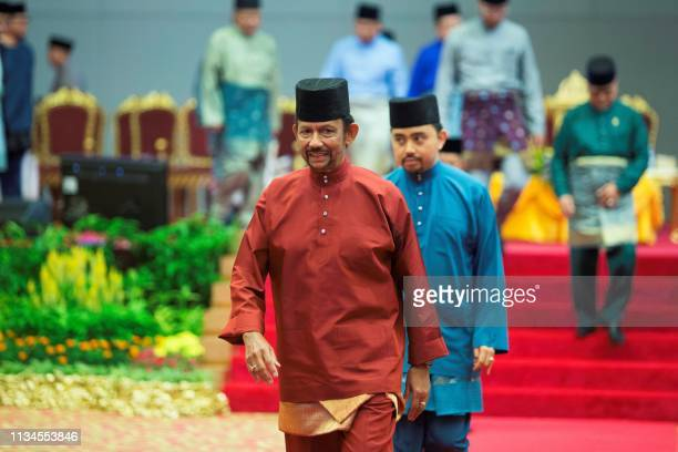 Brunei's Sultan Hassanal Bolkiah leaves after speaking at an event in Bandar Seri Begawan on April 3 2019 Brunei's sultan called for Islamic...