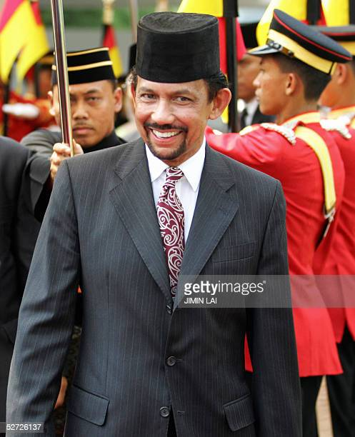 Brunei's Sultan Hassanal Bolkiah smiles during welcoming ceremony at the parliament square in Kuala Lumpur 28 April 2005 Bolkiah is on a fourday...