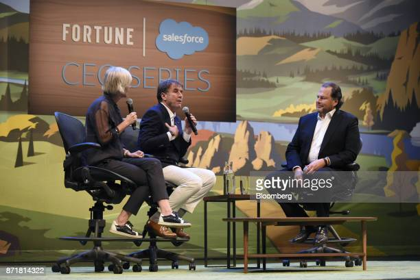 Brunello Cucinelli chief executive officer of Brunello Cucinelli SpA center speaks as Marc Benioff chairman and chief executive officer of...