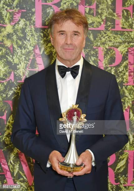 Brunello Cucinelli winner of the Community Social Justice award poses backstage at The Green Carpet Fashion Awards Italia Teatro Alla Scala on...