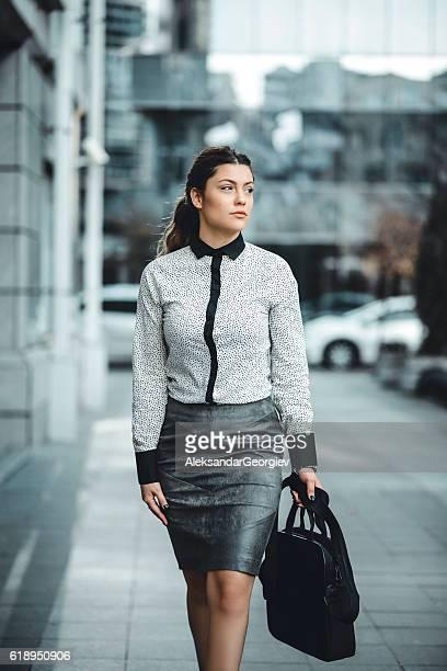 Brunette Businesswoman with LapTop Bag Walking Outdoor on Street