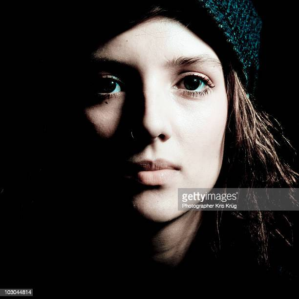 Brunette Female wearing Blue Hat with Shadows