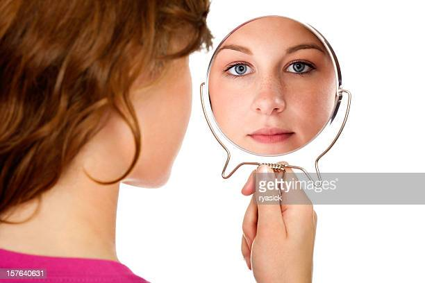 brunette girl from behind  looking through mirror at viewer isolated - hand mirror stock pictures, royalty-free photos & images