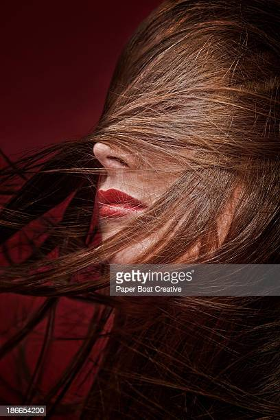 Brunette lady with hair sweeping around her