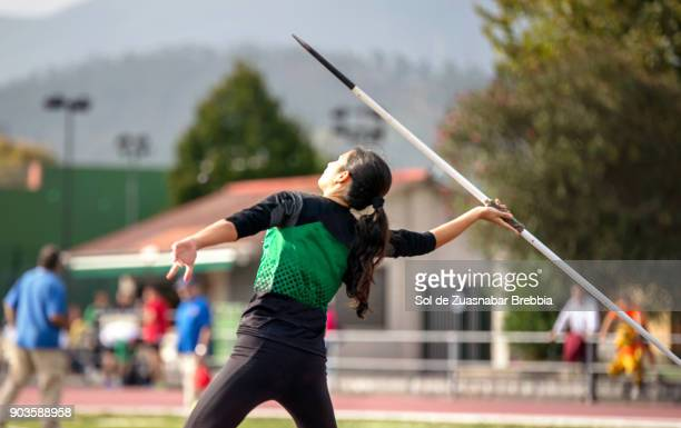 brunette pre-teen girl throwing a javelin - javelin stock pictures, royalty-free photos & images