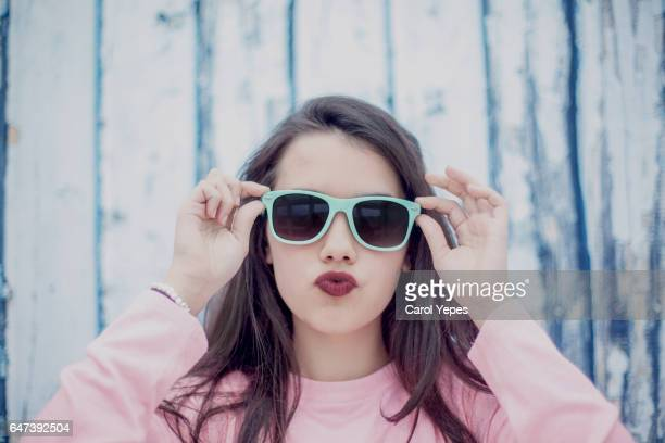 brunette teenager with cool sunglasses