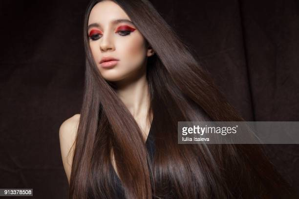 brunette with bright makeup in studio - women flashing stock photos and pictures