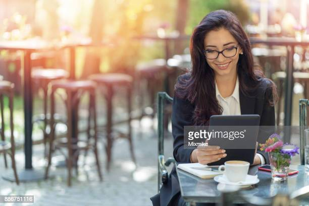 Brunette woman browsing on her digital tablet