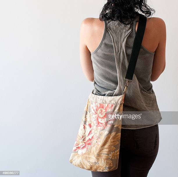 brunette woman from behind - shoulder bag stock pictures, royalty-free photos & images