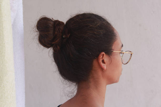 Brunette Woman From The Back Showing Her Hair
