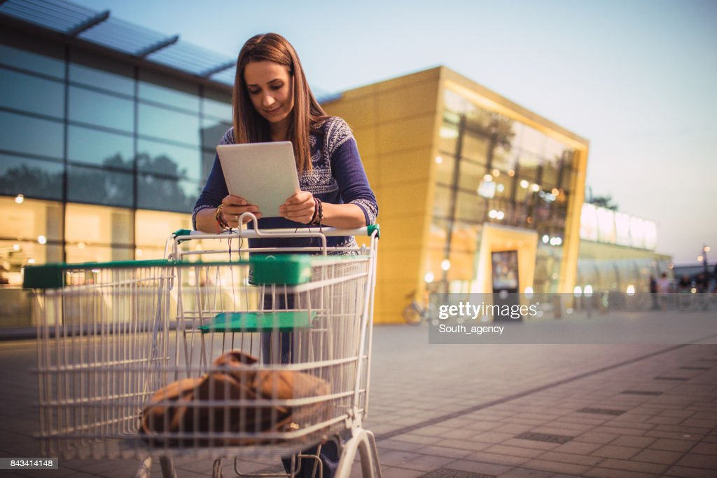 Brunette woman in shopping : Stock Photo