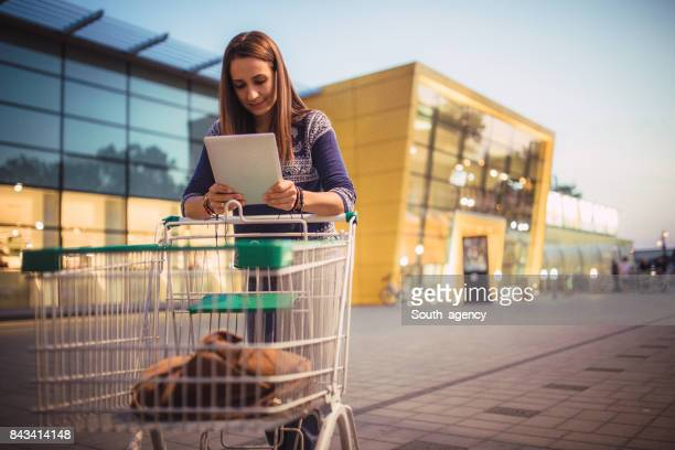 brunette woman in shopping - megastore stock photos and pictures
