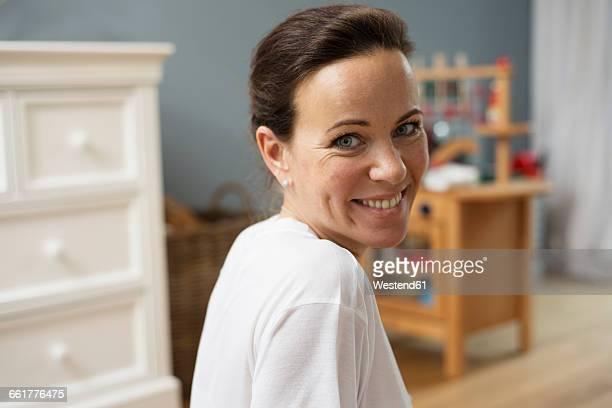 Brunette woman smiling in nursery