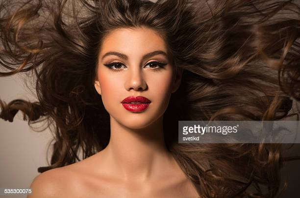 Brunette woman with flying hair.