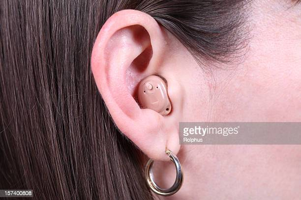 Brunette Woman with Modern Hearing Aid