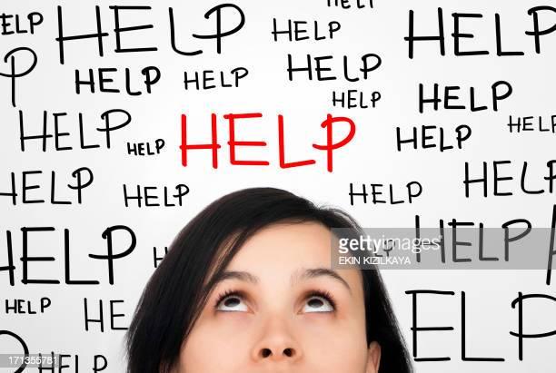 Brunette Women's face with help written all around her