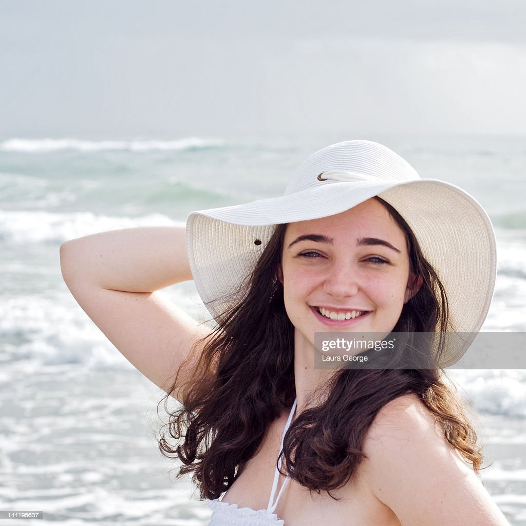 88b8022b Brunette Young Woman In White Summer Hat At Beach Stock Photo ...
