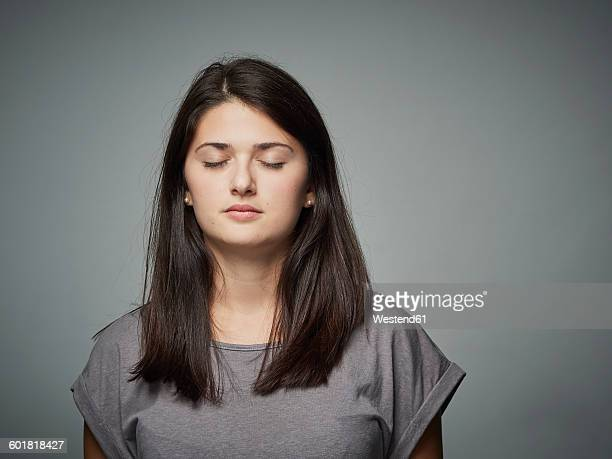 Brunette young woman with closed eyes