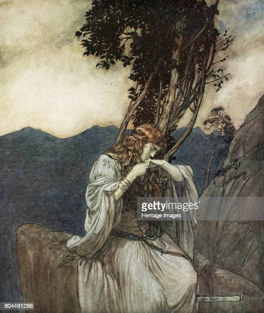 Brunnhilde kisses the ring that Siegfried has left with her' 1924 Illustration from Siegfried and the Twilight of the Gods While Siegfried has been...