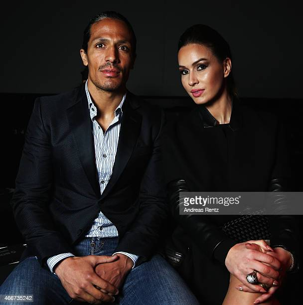 Bruno Alves and guest attend the Hakan Akkaya show during Mercedes Benz Fashion Week Istanbul FW15 on March 18 2015 in Istanbul Turkey