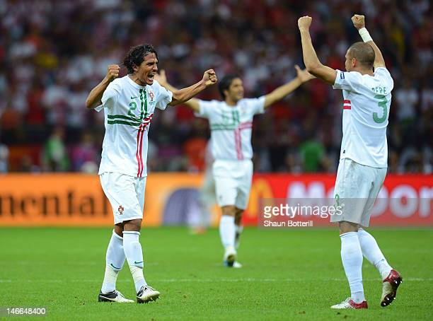 Bruno Alves and Pepe of Portugal celebrate victory and progress to the semifinals during the UEFA EURO 2012 quarter final match between Czech...