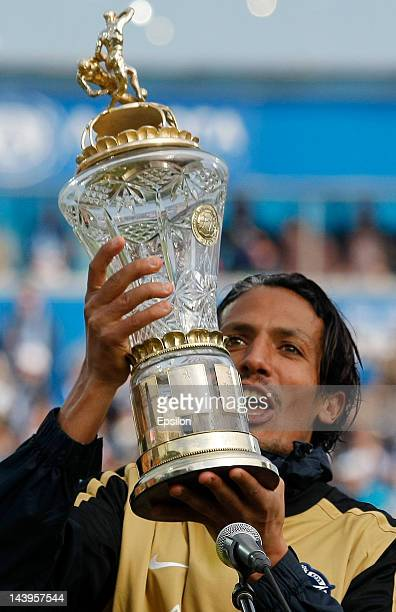 Bruno Alves of FC Zenit St Petersburg holds the Russian champions cup after the Russian Football League Championship match between FC Zenit St...