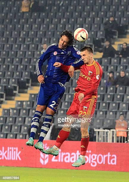 Bruno Alves of Fenerbahce vies with Marko Simic of Kayserispor during Ziraat Turkish Cup football match between Fenerbahce vs Kayserispor in at Sukru...