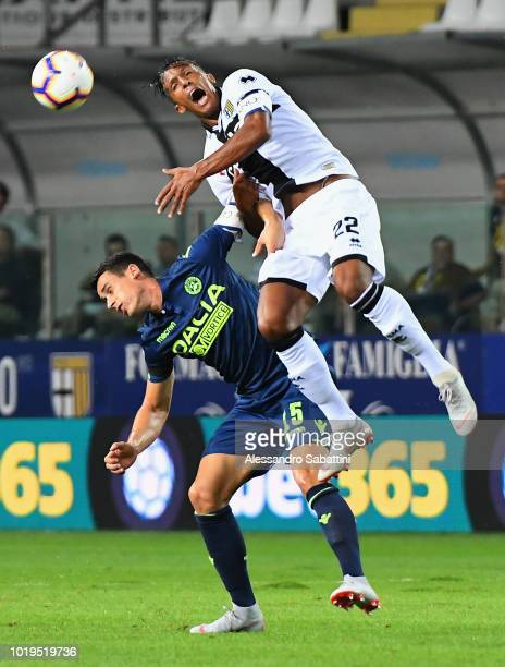 Bruno Alves of Parma Calcio competes for the ball with Kevin Lasagna of Udinese Calcio during the serie A match between Parma Calcio and Udinese at...