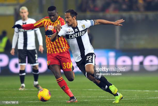 Bruno Alves of Parma Calcio competes for the ball with Khouma Babacar of US Lecce during the Serie A match between Parma Calcio and US Lecce at...