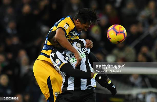 Bruno Alves of Parma Calcio competes for the ball with Stefano OKaka of Udinese during the Serie A match between Udinese and Parma Calcio at Stadio...