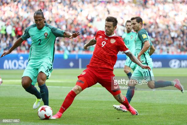 Bruno Alves of Portugal and Fedor Smolov of Russia battle for possession during the FIFA Confederations Cup Russia 2017 Group A match between Russia...