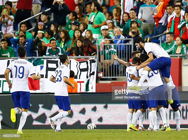 Bruno Alves of Portugal celebrates his goal with teammates in the final seconds of extra time in the second half against Mexico during the...