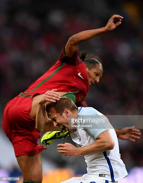 Bruno Alves of Portugal clashes with Harry Kane of England and is sent off during the international friendly match between England and Portugal at...