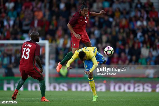 Bruno Alves of Portugal competes for the ball with Viesse Thelin of Sweden during the International friendly match between Portugal and Sweden at...