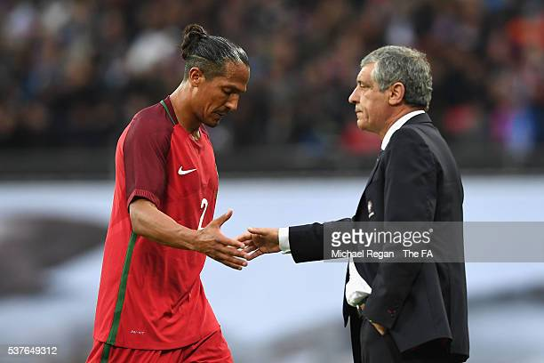 Bruno Alves of Portugal shakes hands with Fernando Santos manager of Portugal after being sent off during the International Friendly match between...