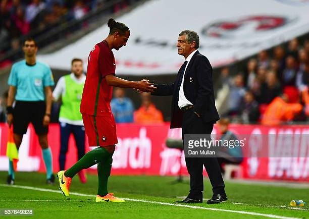 Bruno Alves of Portugal shakes hands with Fernando Santos manager of Portugal as he is sent off during the international friendly match between...