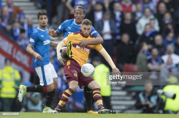 Bruno Alves of Rangers tackles All Campbell of Motherwell during the Betfred Cup Semi Final at Hampden Park on October 22 2017 in Glasgow Scotland
