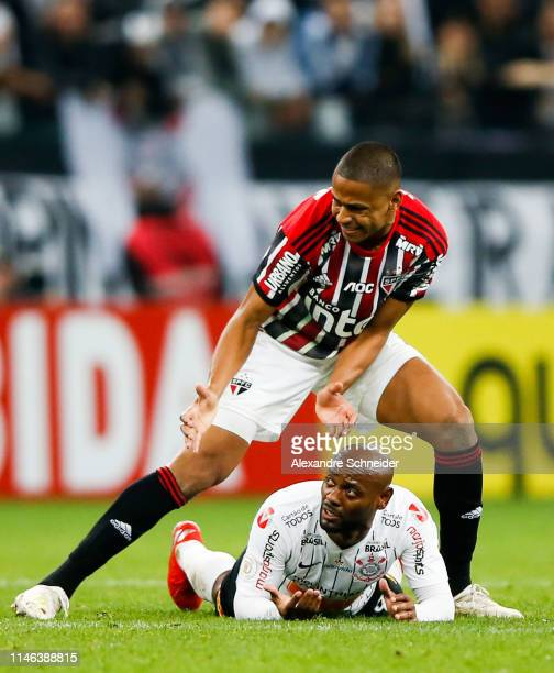 Bruno Alves of Sao Paulo and Vagner Love of Corinthians react during the match for the Brasileirao Series A 2019 at Arena Corinthians Stadium on May...