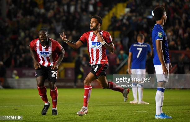 Bruno Andrade of Lincoln City celebrates after scoring his team's second goal during the Carabao Cup Second Round match between Lincoln City and...