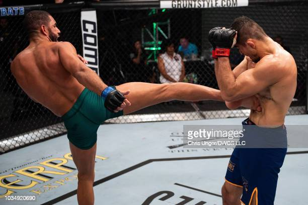 Bruno Assis of Brazil kicks Andre Muniz of Brazil in their middleweight bout during Dana White's Contender Series Brazil at the TUF Gym on August 10...