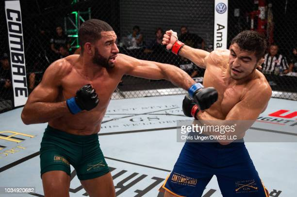 Bruno Assis of Brazil punches Andre Muniz of Brazil in their middleweight bout during Dana White's Contender Series Brazil at the TUF Gym on August...