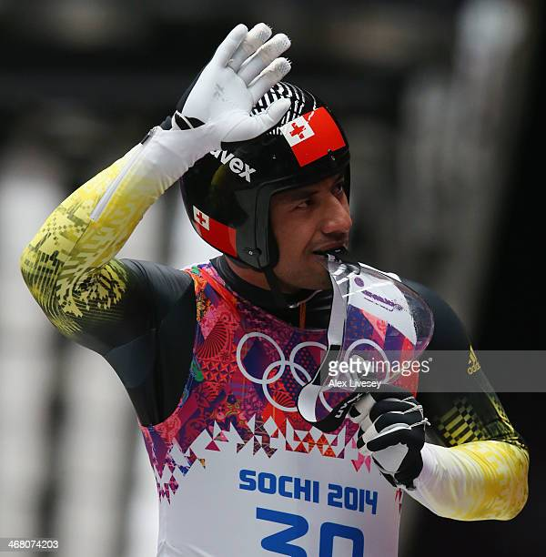 Bruno Banani of Tonga waves after competing during the Men's Luge Singles on Day 2 of the Sochi 2014 Winter Olympics at Sliding Center Sanki on...