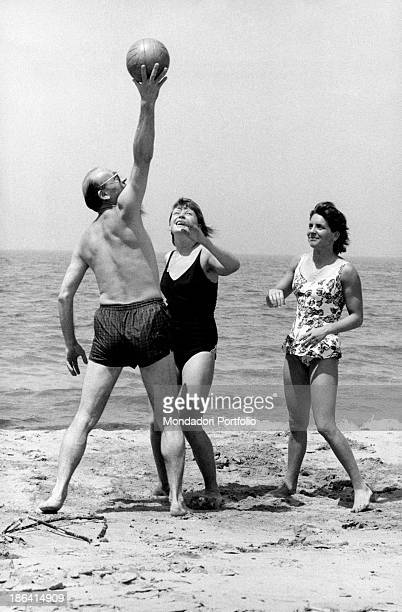 Bruno Beneck former football player and currently a film director for cinema and tv play with a ball on the beach with his daughter Daniela under the...