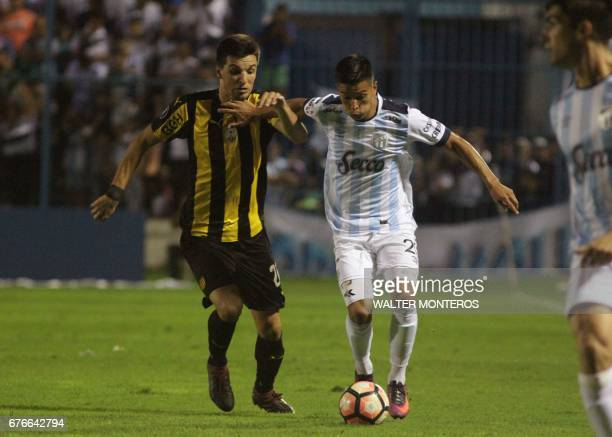 Bruno Bianchi of Argentina's Atletico Tucuman and Mauricio Affonso of Uruguay's Penarol vie for the ball during their Copa Libertadores football...